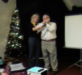Andrew Cole plays harmonica for Xmas carols