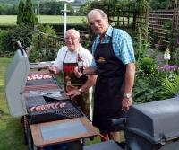 Chefs Richard Hensby and Peter Rhodes practice on the sausages before getting to the serious business of the steaks